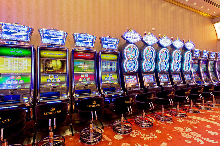 What is the difference between slot machines and video lottery terminals